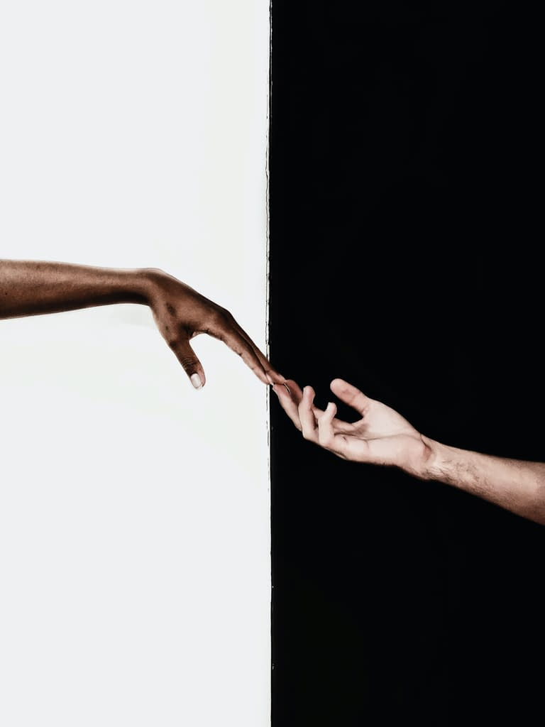 hands in front of white and black background 3541916